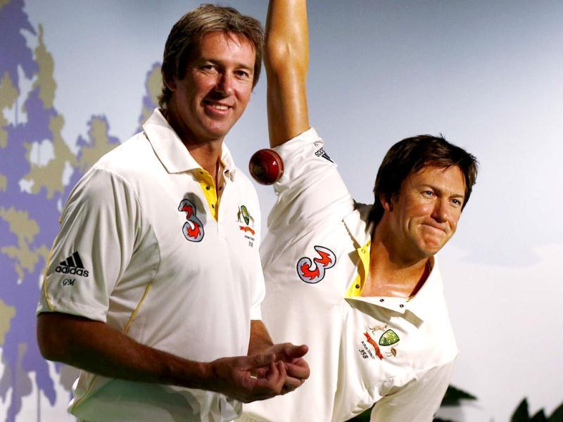 Former Australian cricket player fast bowler Glenn McGrath (L) poses for a picture next to his wax figure during a publicity event at Madame Tussauds wax museum in Sydney. (Reuters Photo)