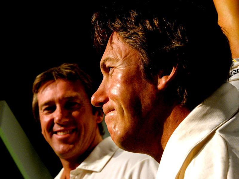 Australia's cricket legend Glenn McGrath (L) looks at the launch of his wax figure (R) at Madame Tussauds in Sydney. McGrath was the winner of the Madame Tussauds Sydney Aussie votes campaign where the Australian public was asked to cast their votes on which Australian sporting hero they wanted to see immortalised in wax. (AFP Photo)