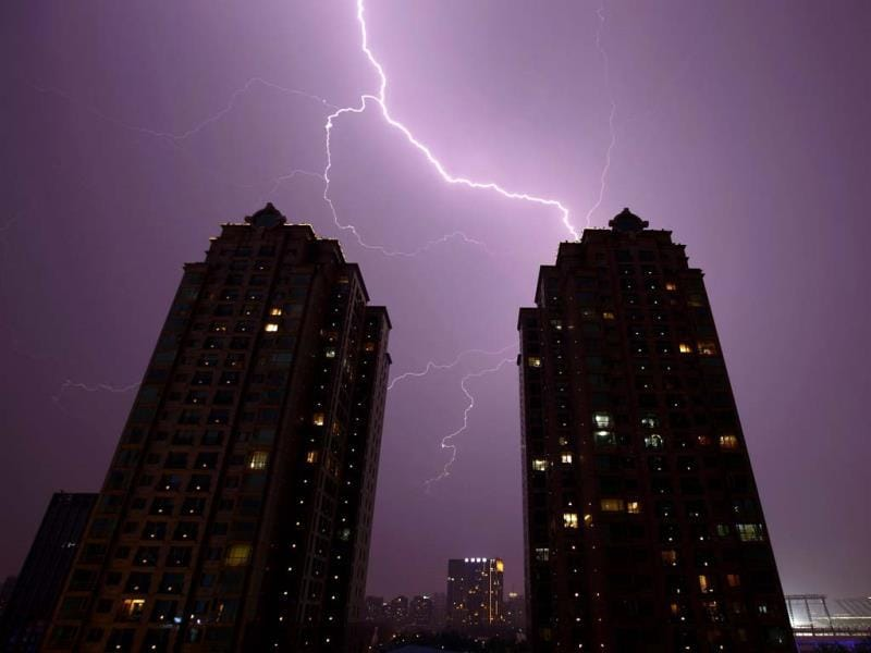 Lightning is seen above buildings in Beijing. (Reuters)