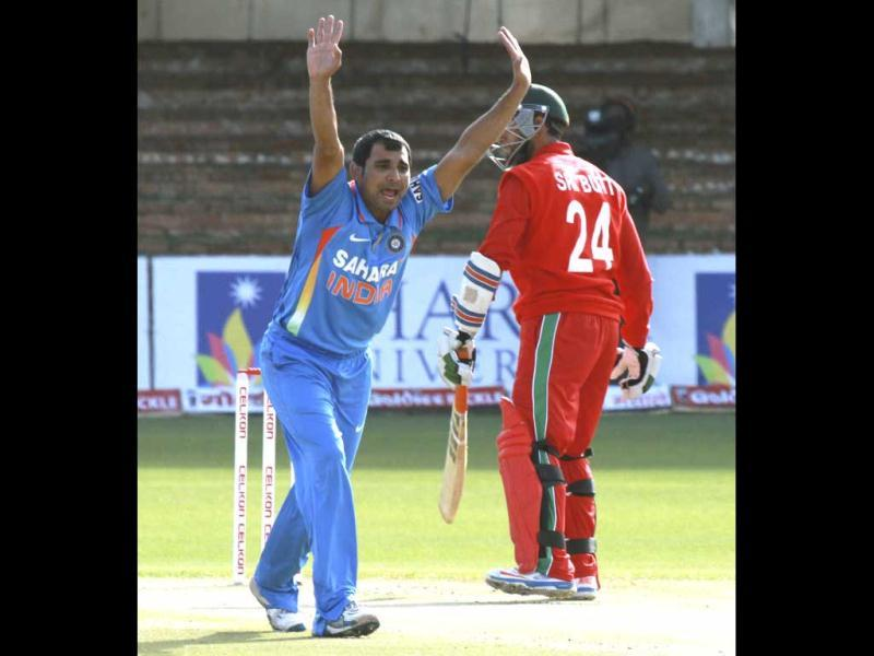 Mohammad Shami, left, appeals unsuccessfully for the wicket of Sikanda Raza Butt during their one-day international cricket match at Queens Sports Club in Bulawayo, Zimbabwe. (AP Photo)