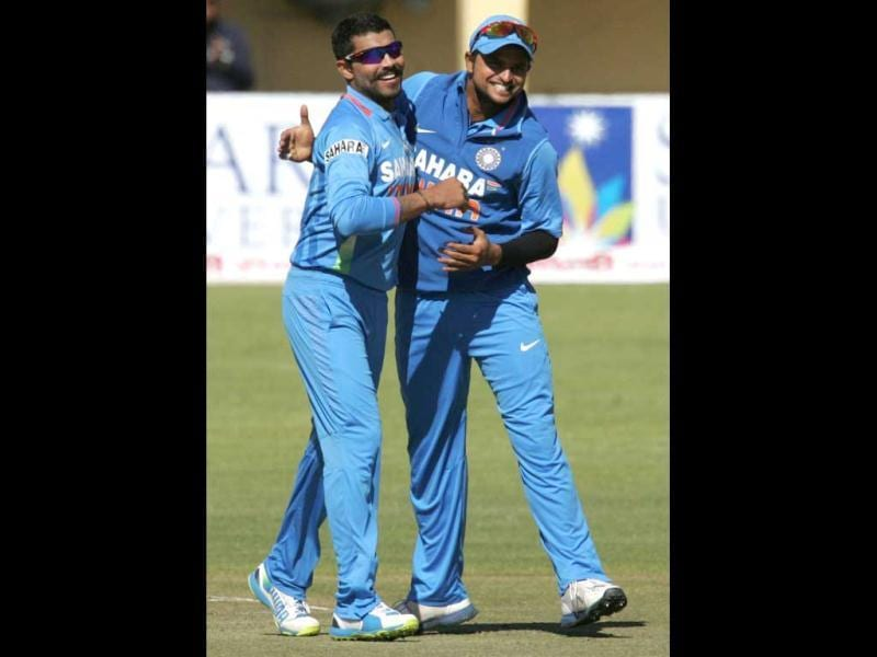 Javindra Jadeja (L) and Suresh Raina celebrate a wicket during the 4th match of the 5-match cricket ODI series between Zimbabwe and India at Queen's Sports Club in Harare. (AFP Photo)