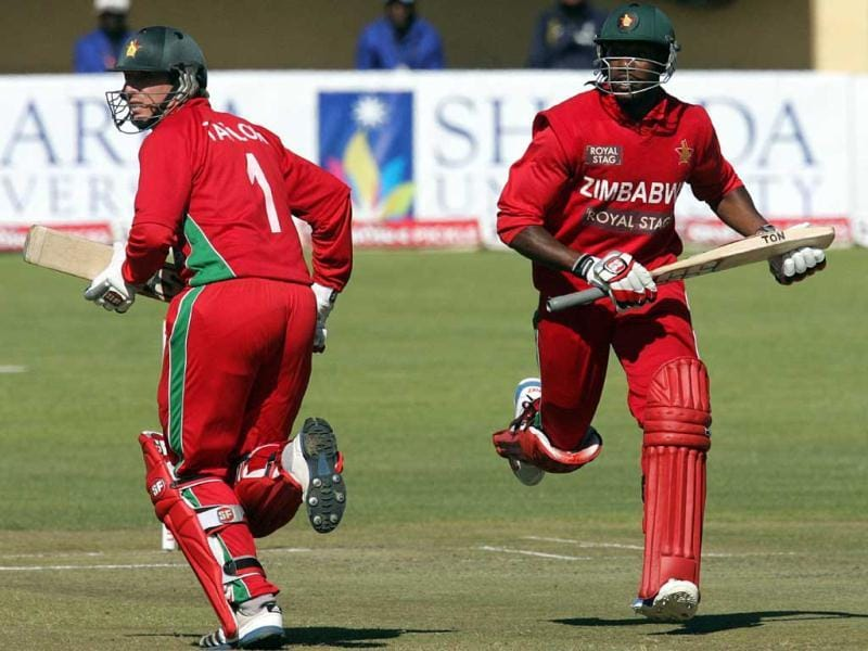 Brendan Taylor (L) runs between the wickets with team mate Vusimuzi Sibanda (L) during the 4th match of the 5-match cricket ODI series between Zimbabwe and India at Queen's Sports Club in Harare. (AFP Photo)