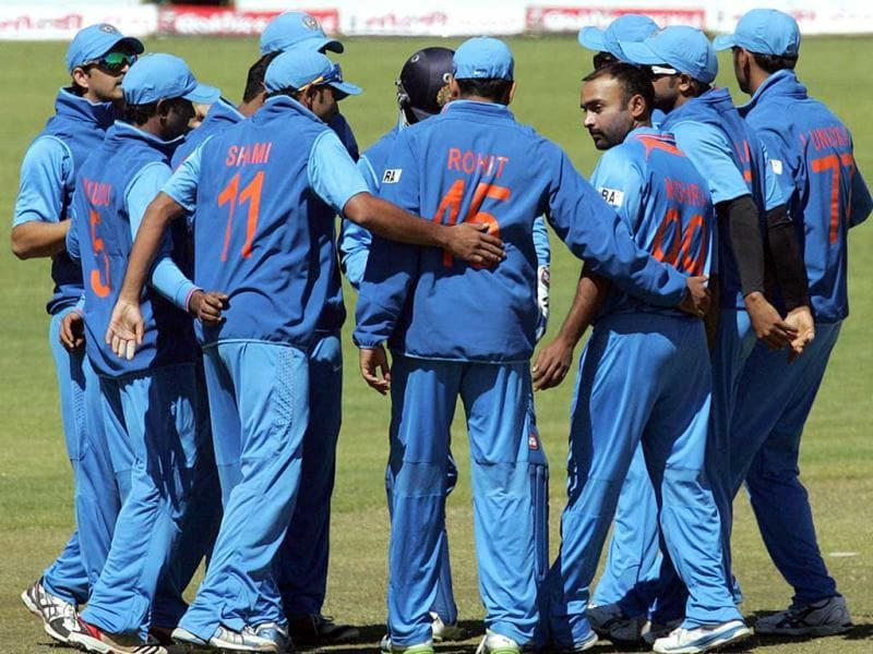 Indian players in a huddle as they have Zimbabwe under pressure during the 4th match of the 5-match cricket ODI series between Zimbabwe and India at Queen's Sports Club in Harare. (AFP Photo)