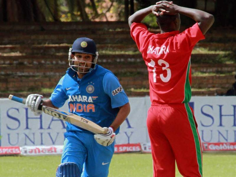 Rohit Sharma, left, makes a run as Tendayi Chatara reacts during the fourth, one day international match against Zimbabwe, at Queens Sports Club, in Bulawayo, Zimbabwe. (AP Photo)