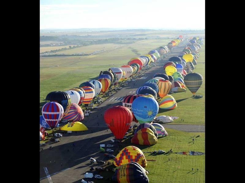 Over 390 hot air-balloons prepare to take off in Chambley-Bussieres, eastern France to set a world record of collective taking-off during the yearly event Lorraine Mondial air ballons. (AP Photo)