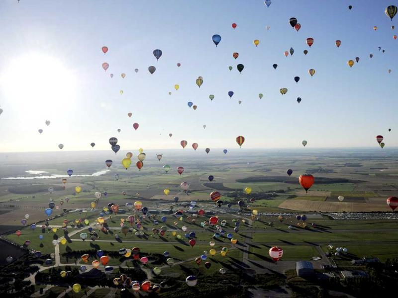 Over 400 hot-air balloons take off in Chambley-Bussieres, eastern France in an attempt to set a world record for collective taking-off during the event Lorraine Mondial air ballons. (AP Photo)