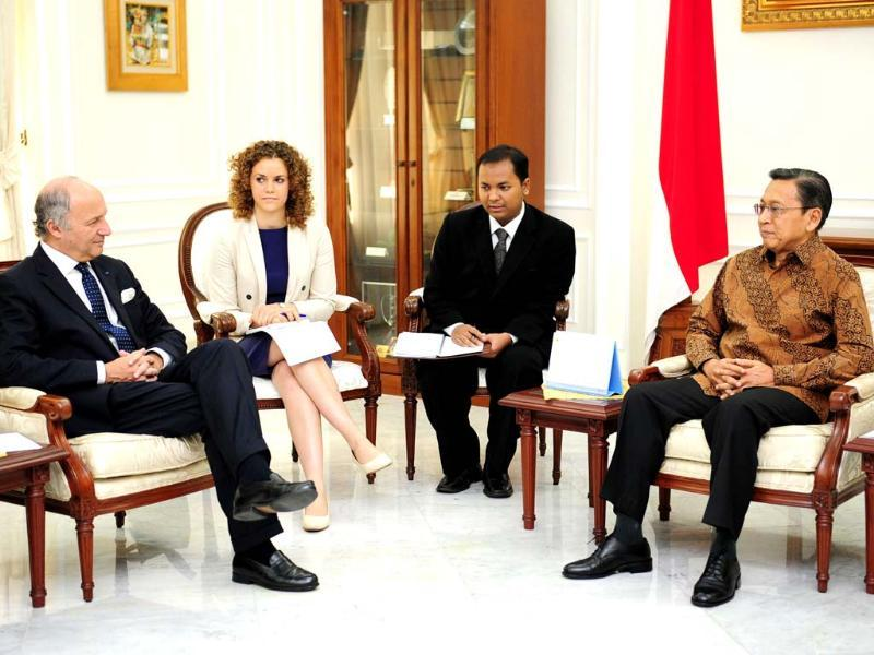 In a handout photo release, Indonesia's vice president Boediono (R) meets visiting French foreign minister Laurent Fabius (L) in Jakarta. (AFP Photo/vice president office)