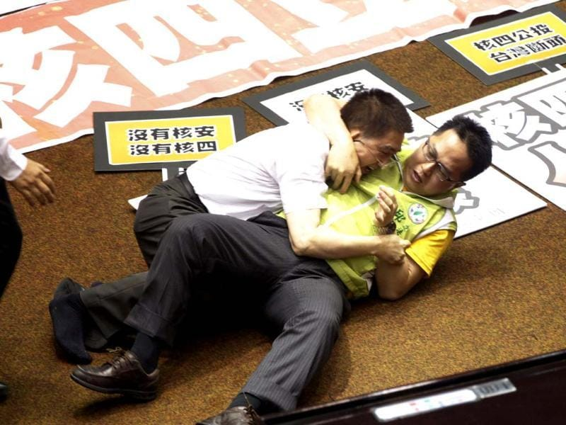 Ruling and opposition lawmakers fight each other on the legislature floor in Taipei, Taiwan. (AP Photo)