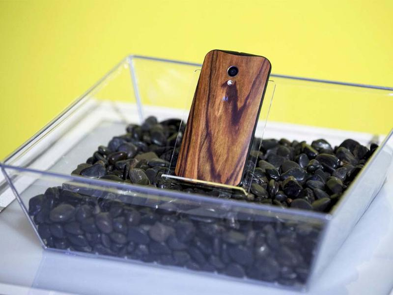 A phone with a wooden back on it rests in a display at a launch event for Motorola's new Moto X phone in New York. Reuters/Lucas Jackson