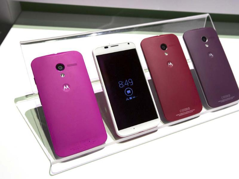 Different colored examples of Motorola's new Moto X phones rest on a table at a launch event in New York. Photo: Reuters/Lucas Jackson