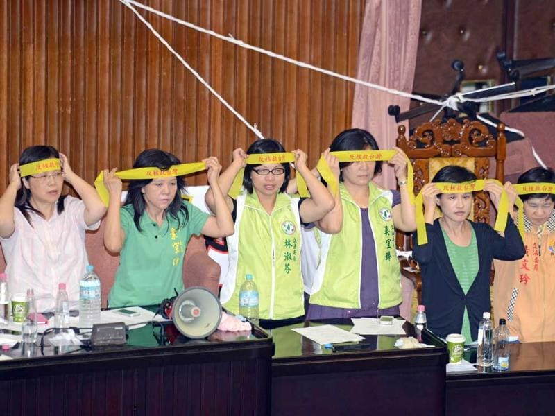 Legislators from Taiwan's main opposition Democratic Progressive Party wear head banners before a vote is taken on whether to build a fourth nuclear power plant at parliament in Taipei. AFP photo