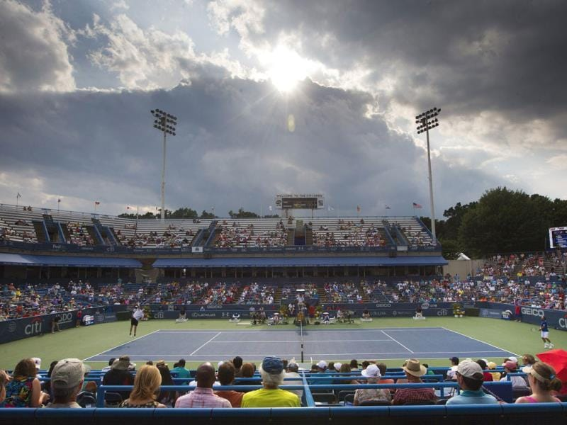 Fans sit in the stands at the William HG FitzGerald Tennis Center as they watch a match between John Isner, left, and Marcos Baghdatis, right, at the Citi Open tennis tournament in Washington. Isner won 6-7, 6-4, 6-4. (AP Photo)