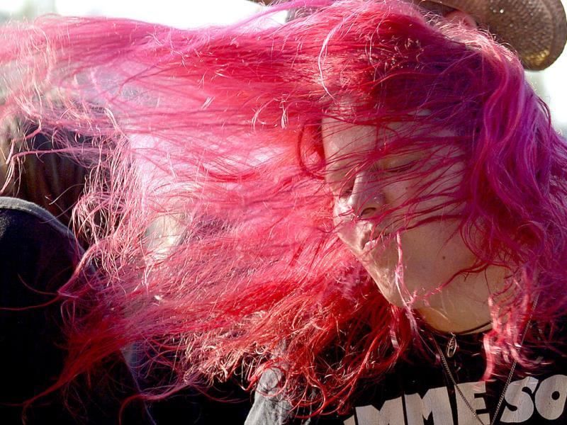 A fan headbangs during a concert at the 24th Wacken Open Air Festival 2013. It is the largest heavy metal festival in the world. (Reuters Photo)