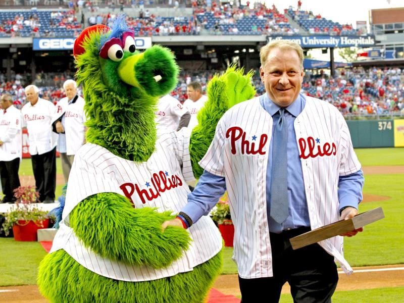 Former Philadelphia Phillie Curt Schilling congratulated by the Phillie Phanatic after his induction into the Phillies 'Wall of Fame'. (AFP Photo)