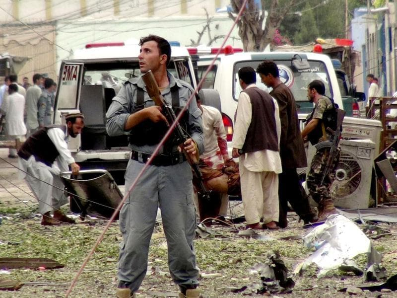 Security officials conduct investigation at the scene of suicide bomb attacks in Jalalabad, Afghanistan. (AP Photo)