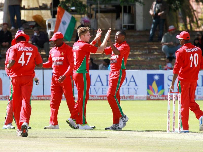 Zimbabwean players celebrate the wicket of Cheteshwar Pujara during the last match of the ODI series against India at the Queens Sports Club in Bulawayo. (AP Photo)