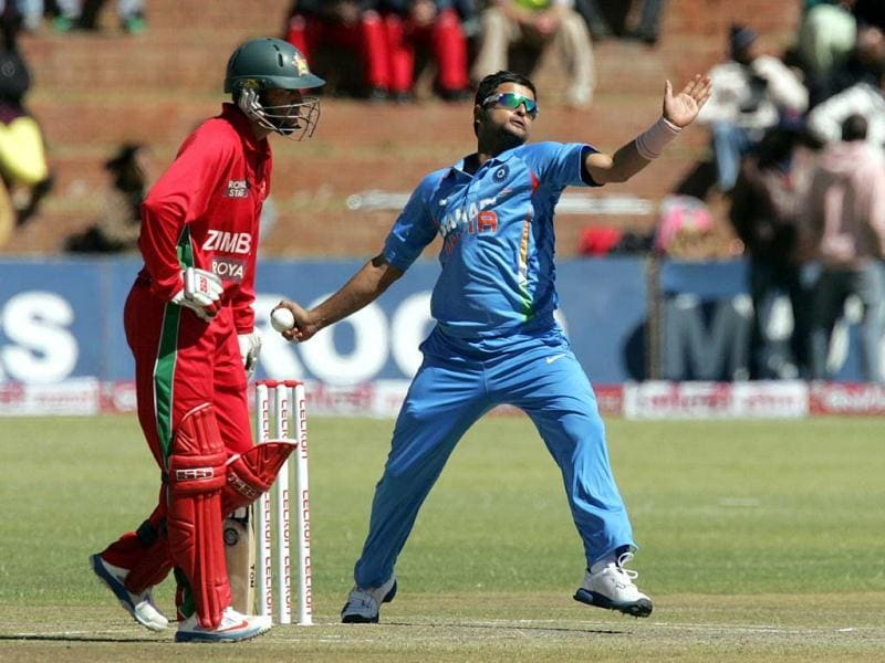 Suresh Raina bowls during the fifth game of the ODI series between hosts Zimbabwe and India at Queens Sports Club in Bulawayo. (AFP Photo)