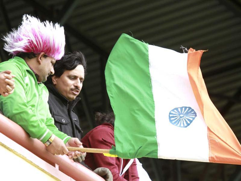 Indian cricket fans wave the tricolour during the last day of the ODI series between India and Zimbabwe at the Queens Sports Club in Bulawayo. (AP Photo)