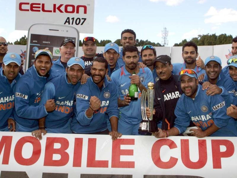 India team celebrates with the Celkon Trophy after winning the final game of the five match ODI series against hosts Zimbabwe at Queens Sports Club. (AFP Photo)