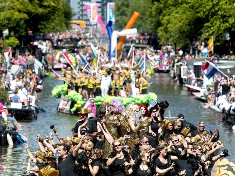 Participants in fancy costumes attend the annual Gay Pride parade or canal parade in Amsterdam. (AFP Photo)