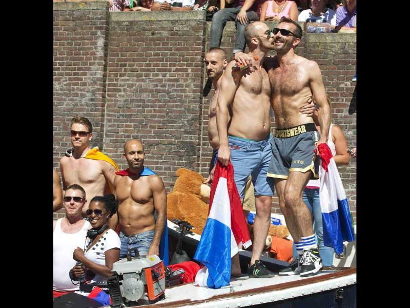 Participants kiss on a barge during the annual Gay Canal Parade in Amsterdam. (Reuters)