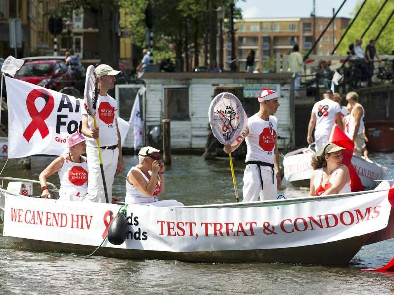 Participants promoting the use of condoms are pictured on a barge during the annual Gay Canal Parade in Amsterdam. (Reuters)