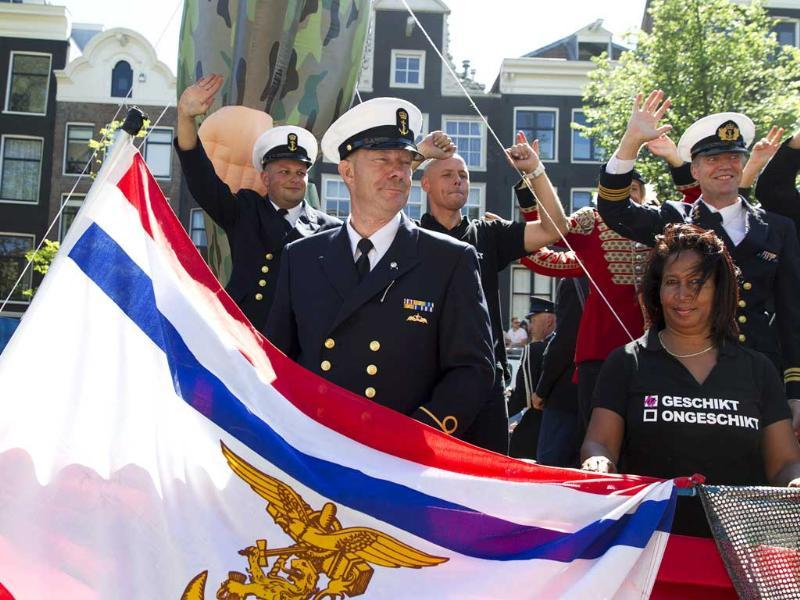 Members of the Dutch military travel on a barge during the annual Gay Canal Parade in Amsterdam. (Reuters)