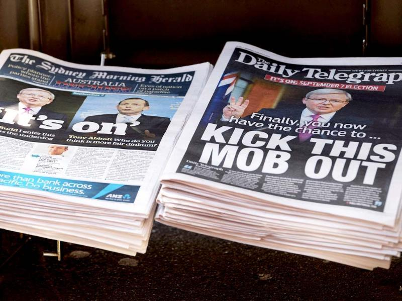 Rupert Murdoch's Sydney Daily Telegraph newspaper, with the Fairfax Media's Sydney Morning Herald newspaper, are displayed on a news stand in Sydney. (AFP photo)