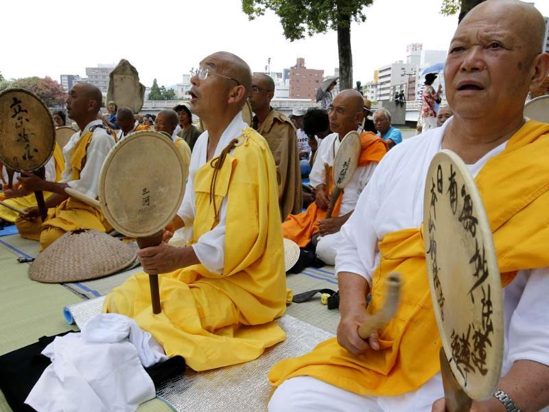 Buddhist monks chant a Buddhist mantra while beating drums in front of the Atomic Bomb Dome in Hiroshima, western Japan (AP Photo)