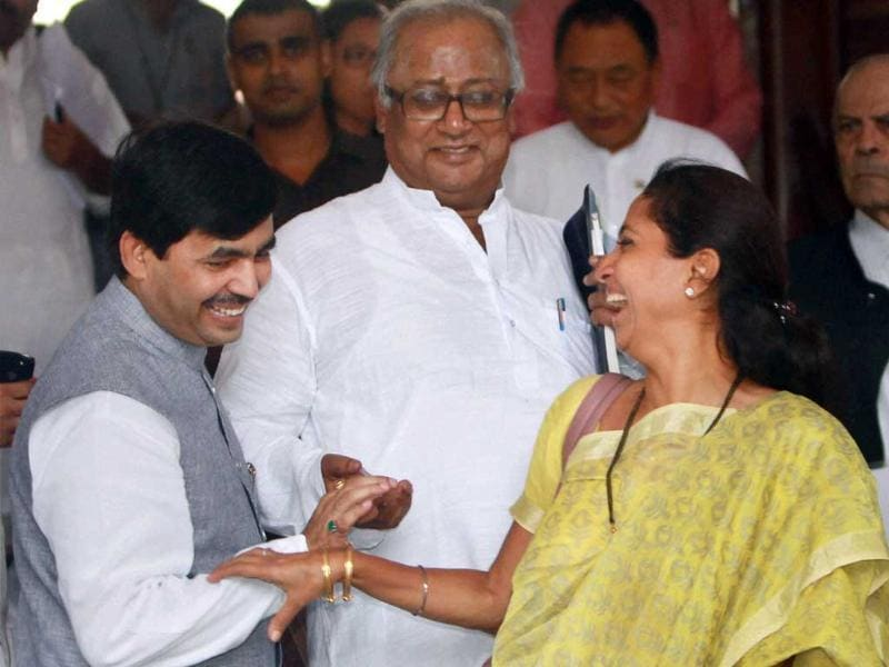 BJP MP Syed Shahnawaz Hussain, NCP MP Supriya Sule and TMC MP Saugata Roy at Parliament House in New Delhi on the first day of monsoon session. PTI Photo