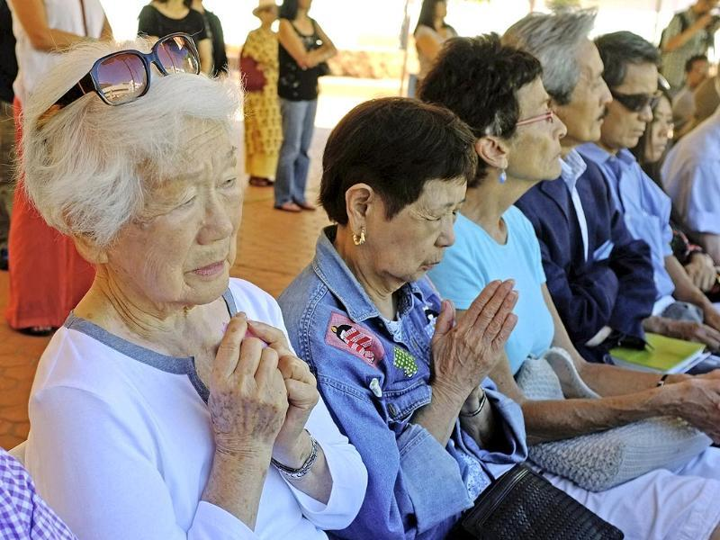 Kiyome Hirayama whose husband was a Japanese solder in Hiroshima, Japan prays at a Buddhist ceremony for peace in Los Angeles. American airmen dropped atomic bombs: Little Boy, on the city of Hiroshima on August 6, 1945, followed by Fat Man, over Nagasaki on Aug. 9, 1945. (AP Photo)