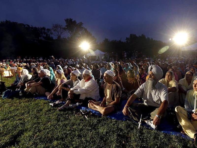 Hundreds participate in a candlelight vigil at the Gurdwara in Wisconsin to mark the one-year anniversary of the shooting rampage that left six dead in Oak Creek, Wisconsin. (AP Photo)