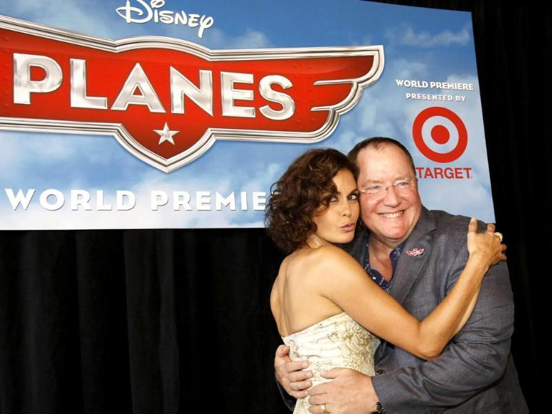John Lasseter, chief creative officer at Pixar and Walt Disney animation studios, poses with actress Teri Hatcher, who voices the character of Dottie, at the world premiere of Planes at El Capitan theatre in Hollywood, California. (Reuters photo)