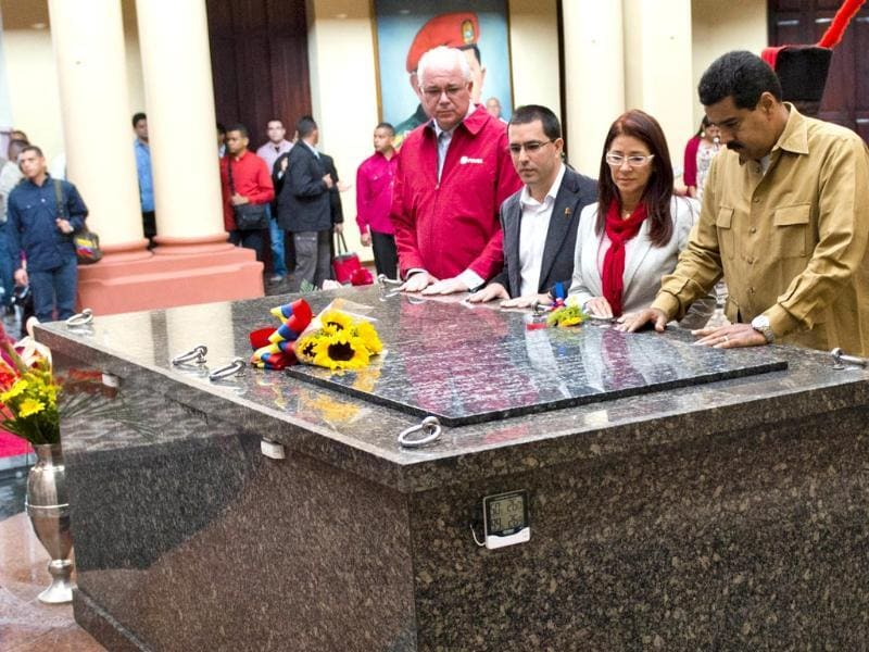 Venezuelan President Nicolas Maduro, his wife Cilia Flores and others pay homage to the late Venezuelan former president Hugo Chavez to commemorate five months of his death, at the Cuartel de la Montana in Caracas. AFP photo