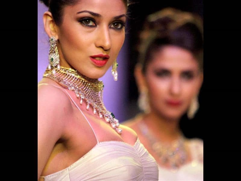 A model walks the ramp during the 'India International Jewellery Week' in Mumbai. (PTI Photo)
