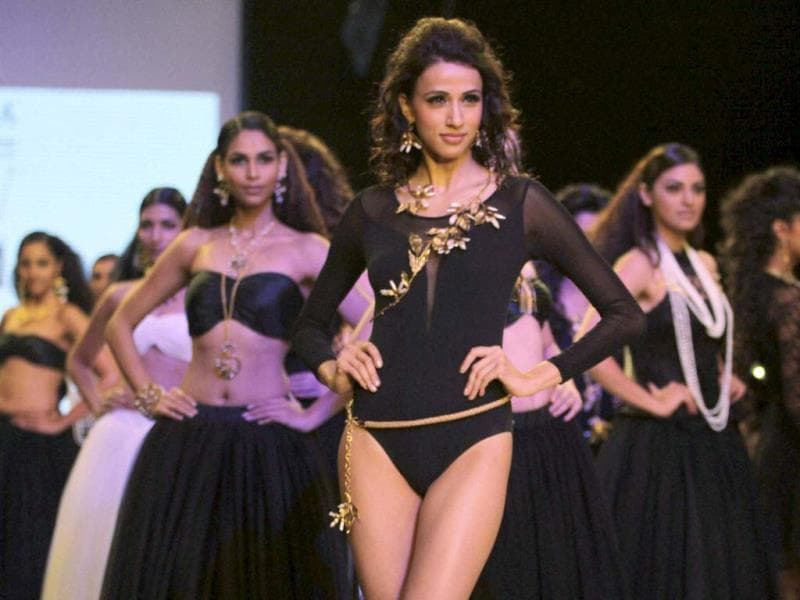 Models walk the ramp during the India International Jewellery Week in Mumbai. (PTI Photo)