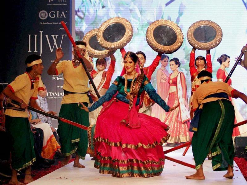 A model performs a traditional dance during the Indian International Jewellery Week in Mumbai. (PTI Photo)