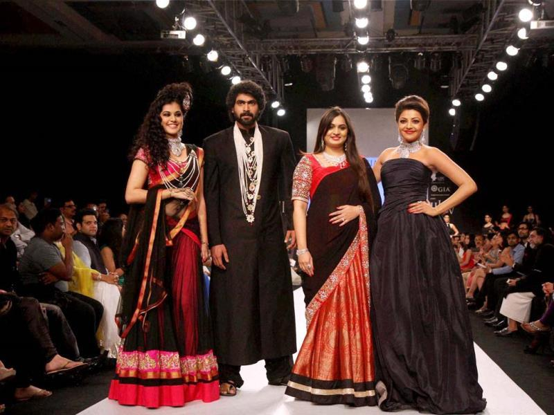 Bollywood actors Rana Dagubatti and Kajol Aggarwal along with models walks the ramp during India International Jewellery Week (IIJW) 2013 at Grand Hyatt in Mumbai on Monday. (PTI Photo)