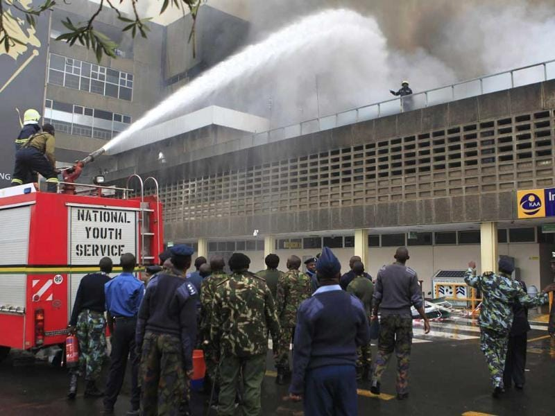 Fire fighters struggle to put out a fire at the Jomo Kenyatta International Airport in Kenya's capital Nairobi. (Reuters)