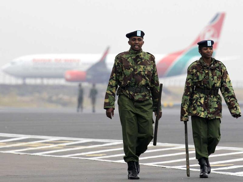 Kenya Airways aircrafts stay grounded after a huge fire left all flights suspended at the Jomo Kenyatta International Airport, as soldiers patrols the grounds, in Kenya's capital Nairobi, Kenya. (Reuters Photo)