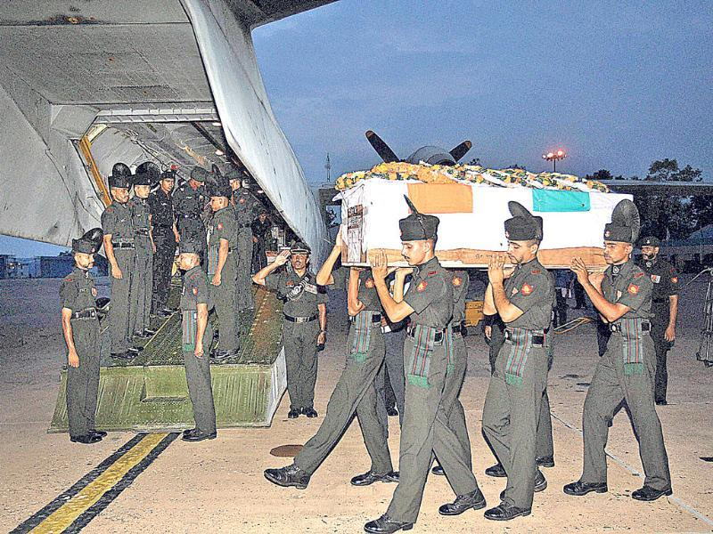 Soldiers carrying the coffin of one of the 5 army jawans, who were killed in an attack in Poonch, after their mortal remains were brought at Palam Technical Airport in New Delhi. (PTI Photo)