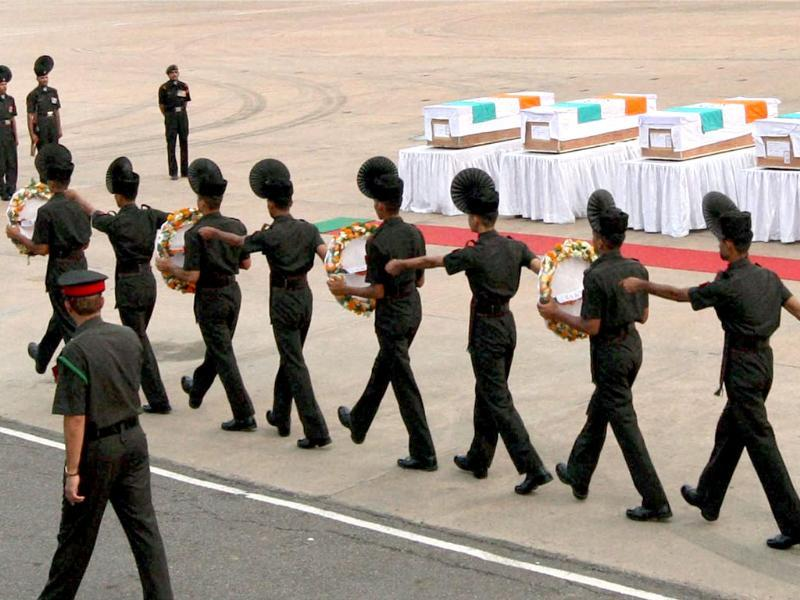 Soldiers paying tributes to 5 army jawans, who were killed in an attack in Poonch, after their mortal remains were brought at Palam Technical Airport in New Delhi. (PTI Photo)