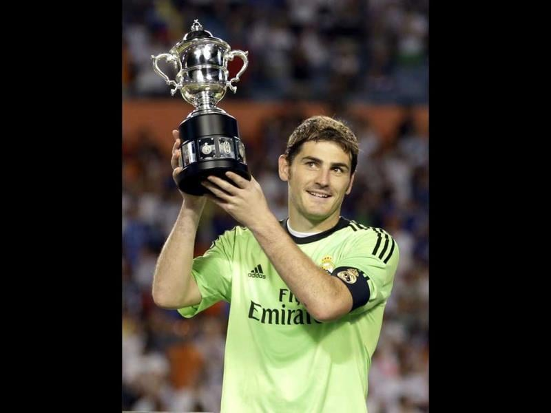 Real Madrid goalkeeper Iker Casillas holds the Guinness International Champions Cup after his team defeated Chelsea 3-1 in the final of the soccer event in Miami Gardens, Florida. (AP Photo)