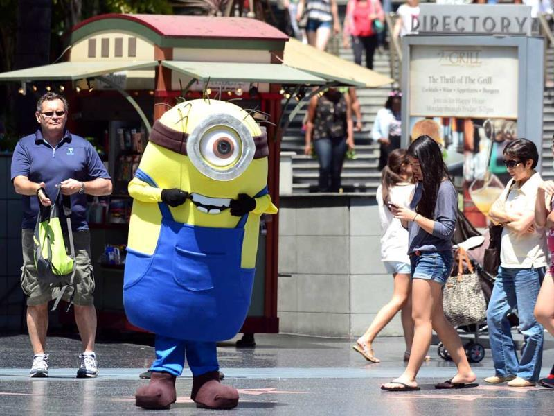 A man dressed in a Minion costume from the Despicable Me movies walks along Hollywood Boulevard as tourists walk by in California. AFP photo