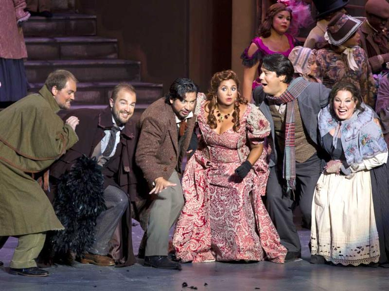 Actors perform in Giacomo Puccini's La Boheme at the National Theatre in Santo Domingo. AFP photo