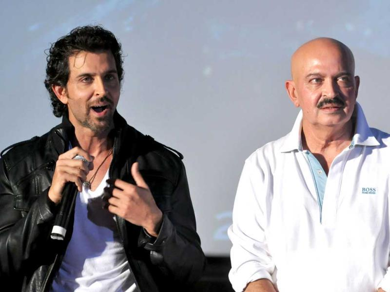 Hrithik Roshan speaks as father Rakesh Roshan looks on at the trailer launch of Krrish 3.