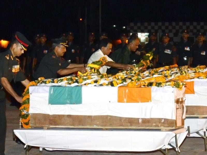 Indian Army officers pay their respects over the caskets of five soldiers killed in Poonch at the Patna Airport in Patna. AFP photo