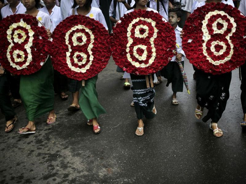 Members of Myanmar's prominent 88 generation students group hold symbolic wreaths during a march in downtown Yangon, Myanmar. (AP Photo)