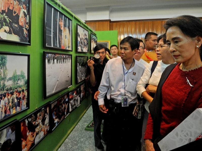 Myanmar democracy leader Aung San Suu Kyi visits a photo exhibition during the