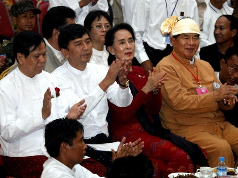Myanmar opposition leader Aung San Suu Kyi (C) and others attend the 25th anniversary of Myanmar's pro-democracy uprising at Myanmar Convention Centre in Yangon. (AP Photo)